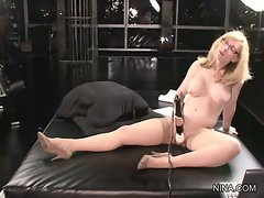 Sassy Nina Hartley toys her dripping wet muff fluff