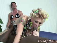 Candy Monroe swallows a huge fuck shaft of black guy