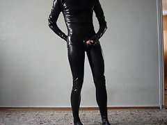 young man in latex catsuit jerks off