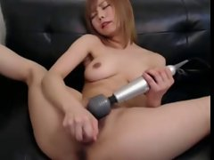 Japanese girl uses hitachi wand on her hairy pussy