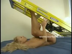 Blonde fucks a machine hard also gettig her clit flogged while riding a differen