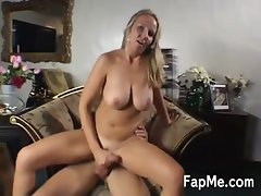 Curvy blonde massaging a cock