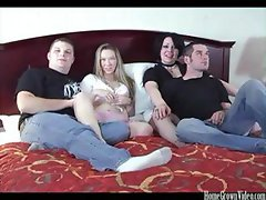 Two couples do some partner swapping in this bedroom four-way