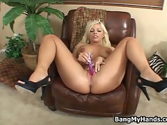 Britney Amber showing her big tits and toying her tight pink pussy
