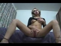 Blonde amateur in a skirt masturbates her pussy