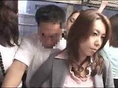 Asian babe strokes his cock on a public bus