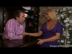 Hot cougar putting the moves on a bartender