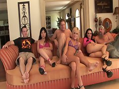 Lovely ladies gagging in sizzling hot blowjob orgy session on couch