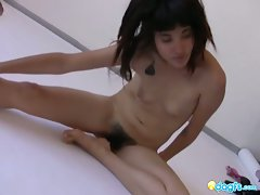 Skinny asian chick poses naked showing her hairy pussy
