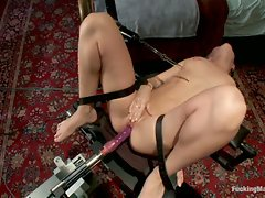 Amateur co-ed girl pulled by a machine back and forth onto a moving...
