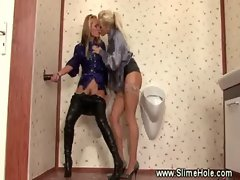 Lesbians getting hot with glory hole in the bathroom