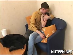 Handsome guy kisses lips of cute teen girl