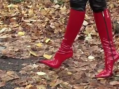filthy lassie walking in leatherfetish panty, corset & red boots