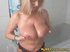 Great buxom blond Mum massaging her enormous boobs in shower